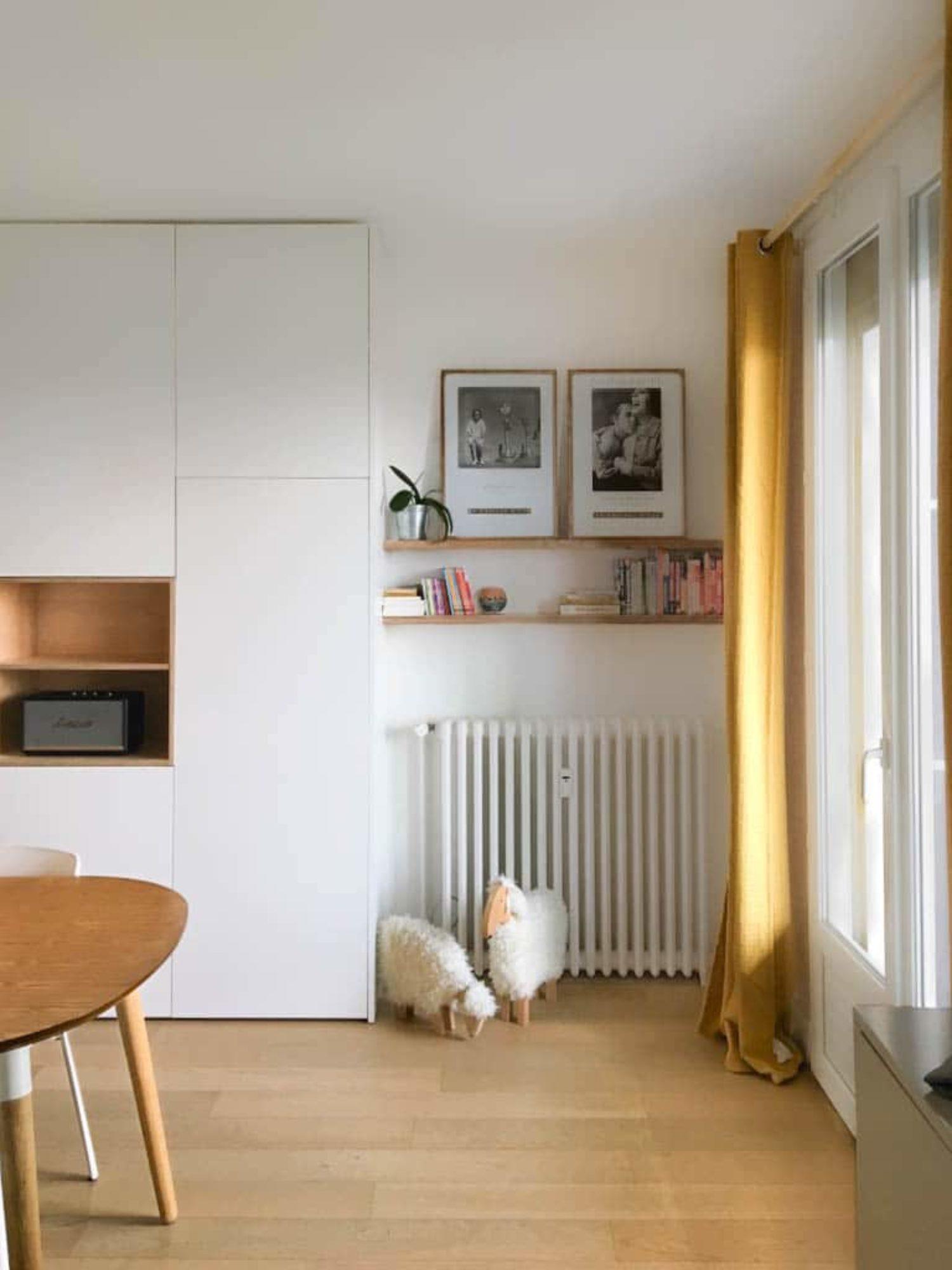 MEUBLE DE RANGEMENT • Un meuble sur mesure, intégrant bibliothèque, placards et niches décoration.